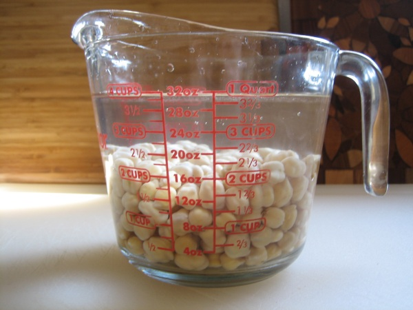 soaked garbanzo beans in measuring cup